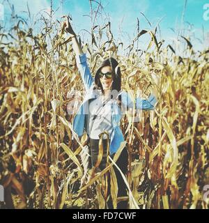 Portrait Of Happy Woman In Agricultural Field - Stock Photo