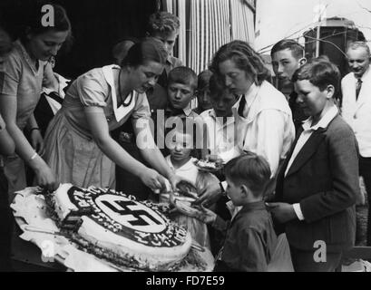 Hitler's birthday cake is being shared, 1934 - Stock Photo