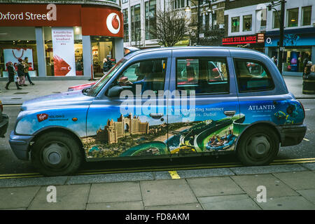 London Taxi Cab in Oxford Street - Stock Photo
