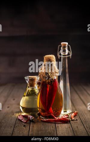 Three bottles of assorted olive oil bottles - Stock Photo