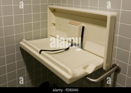 Folding Baby Changing Table In Public Restroom   USA   Stock Photo