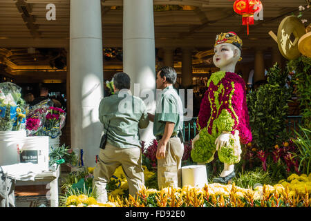 ... Gardeners Maintaining The Flower Beds At The Gardens In The Bellagio  Casino And Resort In Las