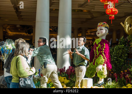 Gardeners Maintaining The Flower Beds At The Gardens In The Bellagio Casino  And Resort In Las