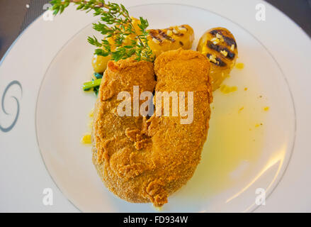 Breaded blood sausage in Azores style, Lisbon, Portugal - Stock Photo