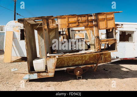 An abandoned camping trailer in Bombay Beach, California, on the eastern shore of the Salton Sea - Stock Photo