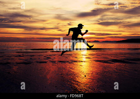 Man Running On Beach - Stock Photo