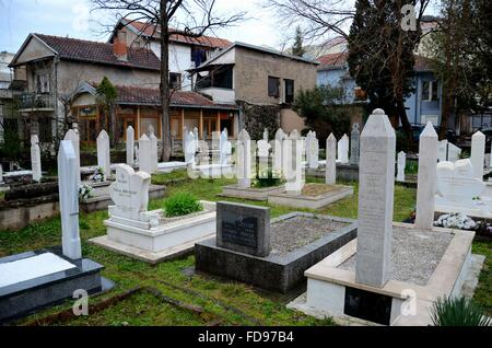 Muslim graveyard ornate marble tombstones at Mostar Islamic cemetery Bosnia Herzegovina - Stock Photo