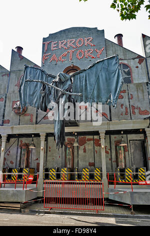 Haunted-House in the biggest fun fair in Brussels on 20 july, 2014. The Grim reaper standing above the entrance - Stock Photo