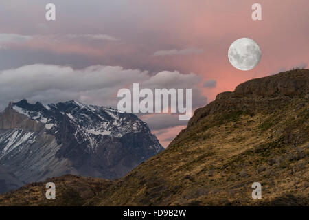 Moon rising over Cuernos del Paine, Torres del Paine National Park, Chilean Patagonia, Chile - Stock Photo