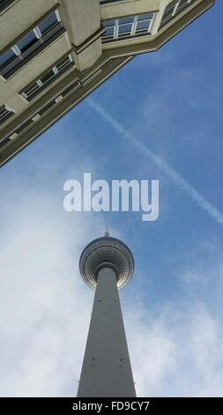 Low Angle View Of Fernsehturm And Building Against Sky - Stock Photo