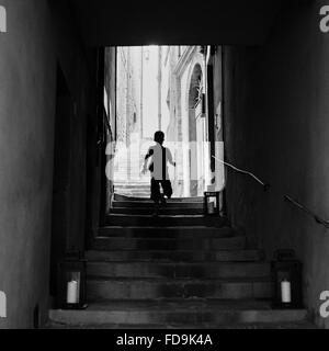 Silhouette Of Boy On Steps - Stock Photo