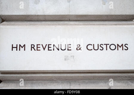 The sign for HM Revenue and Customs on the office building in Whitehall London UK (Tax office)