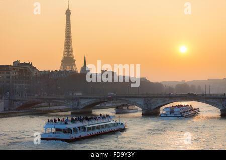 Paris Cityscape, sunset on Seine river - Stock Photo