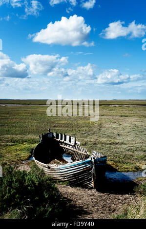 Abandoned rowing boat in coastal Norfolk, England, UK - Stock Photo