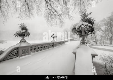 Black & White view of the Bow Bridge in Central Park covered in snow during the blizzard of January 2016. Manhattan, - Stock Photo