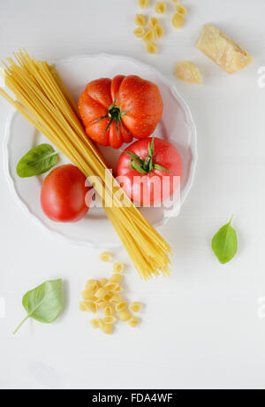 cooking pasta with tomato and cheese, top view - Stock Photo