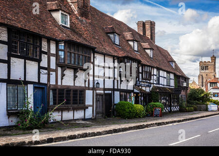 All Saints church and Ye Mayedes restaurant in the pretty village of Biddenden in Kent. - Stock Photo