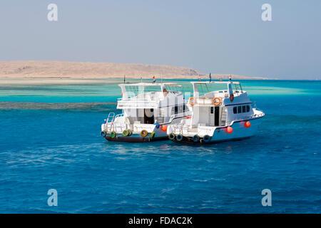 Boats anchored outside Giftin Island. Red Sea, Egypt. - Stock Photo