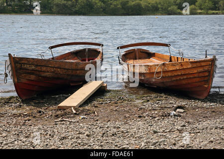 Rowing boats on the shore of Derwentwater, Lake District - Stock Photo