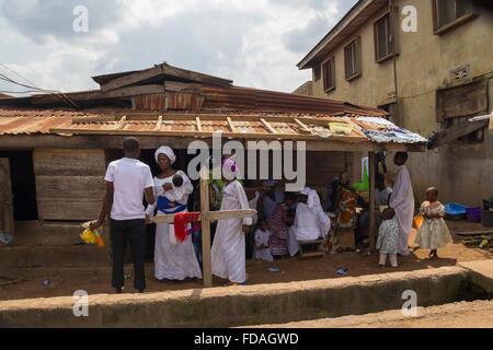 Some african people dressing white clothes, in a religious ceremony at the city of Akure, Nigeria - Stock Photo