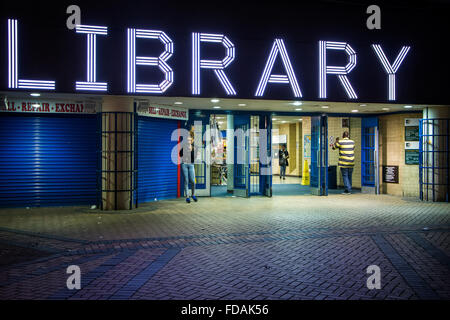 New iconic neon light sign at night, West Green Library in North London - Stock Photo