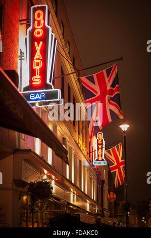 Neon lights of historic Quo Vadis Private Club in Soho, London - Stock Photo