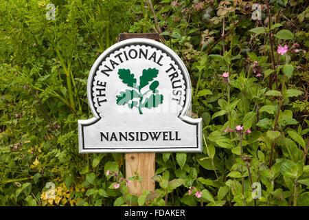 National Trust omega sign saying Nansidwell Cornwall England UK - Stock Photo