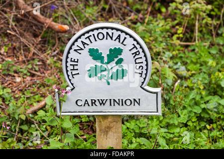 National Trust omega sign saying Carwinion Cornwall England UK - Stock Photo
