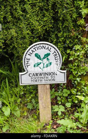 National Trust omega sign saying Carwinion footpath to Porth Saxon Cornwall England UK - Stock Photo
