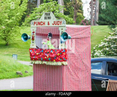 A traditional Punch and Judy puppet show booth with the Policeman - Stock Photo