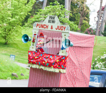A traditional Punch and Judy puppet show booth with Mr Punch - Stock Photo