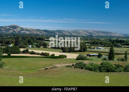 New Zealand, Dunedin. View of the outskirts of Dunedin from the Taieri Gorge scenic train from Dunedin to Pukerangi - Stock Photo