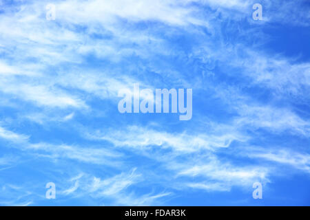 Blue sky with light clouds -  may be used as background - Stock Photo