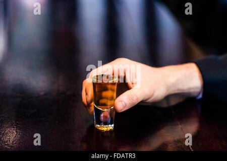 Man holding a shot - Stock Photo