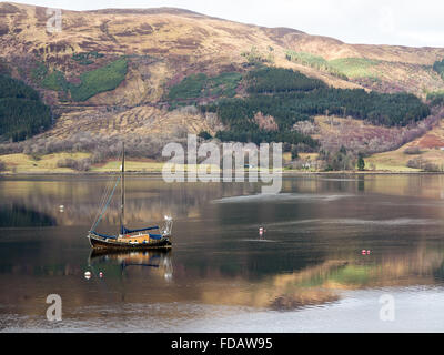A boat on Loch Leven sea water loch near Fort William and Glencoe in Perth and Kinross council area, central Scotland. - Stock Photo