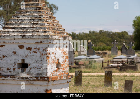 Rural cemetery with old chinese tombs and burials in the background. - Stock Photo