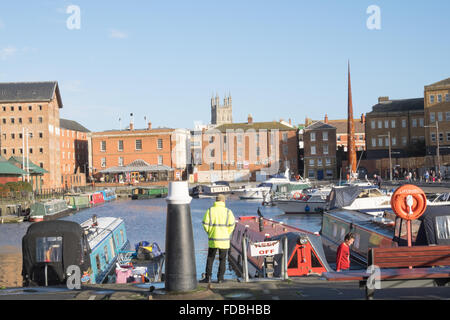 Boats moored at the Victorian basin in Gloucester docks - Stock Photo