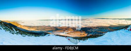 TATRANSKA LOMNICA, SLOVAKIA - DEC 23, 2015: Panoramic view of ski resort in Tatranska Lomnica, High Tatras. - Stock Photo