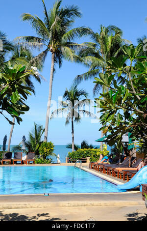 Hotel swimming pool beside the picturesque Coco Palm Beach Resort on Koh Samui island, Thailand - Stock Photo