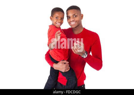 African American man with holding  his little boy isolated on white background - Stock Photo