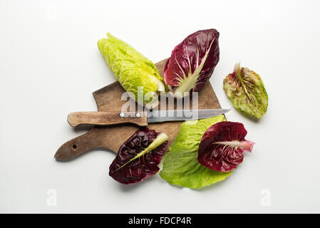 Fresh mixed salad leaves with radicchio on a white background. - Stock Photo