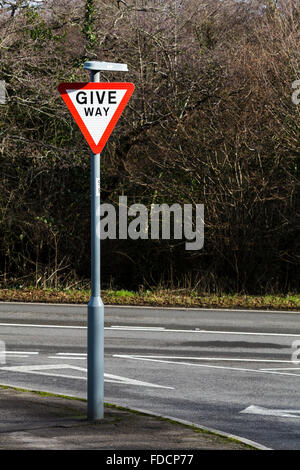 A Give Way road sign on an empty road. - Stock Photo