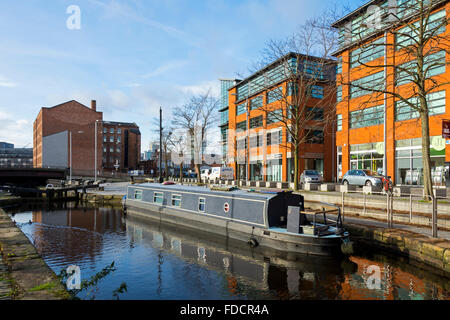 Narrowboat on the Rochdale Canal next to the MM2 buildings, Redhill Street, Ancoats, Manchester, UK - Stock Photo