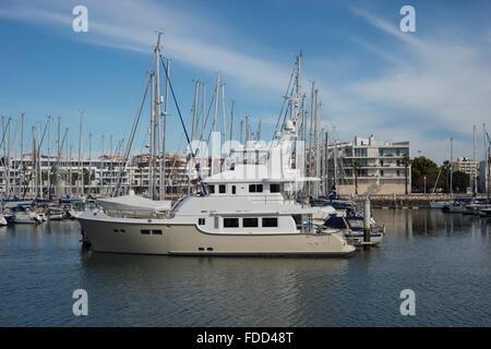 Nordhavn motor yacht moored in Lagos Marina in the Algarve, Portugal. - Stock Photo