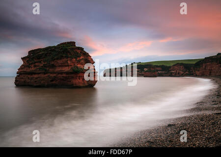 A sea stack at Ladram Bay near Sidmouth in South East Devon captured at sunset. - Stock Photo