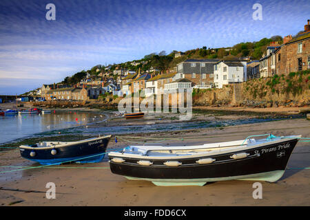 Boats at Mousehole Harbour near Penzance in Cornwall. - Stock Photo