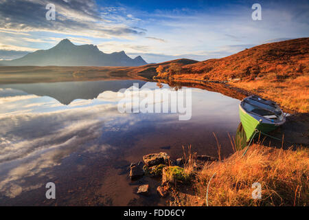 A boat on Loch Hakel near Tongue in North West Scotland, with Ben Loyal in the distance. - Stock Photo