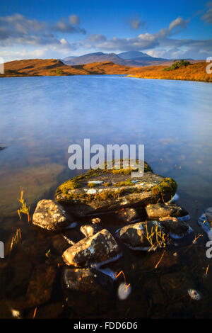 Loch Hakel near Tongue in North West Scotland, with Ben Hope in the distance. - Stock Photo