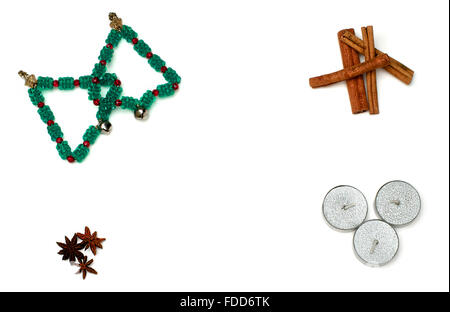 Christmas trees, candles and cinnamon over white - Stock Photo