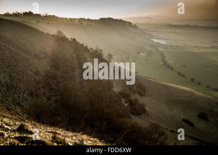 Frost hillside slopes & sunset over Wiltshire countryside near the town of Westbury from Bratton Camp and Westbury - Stock Photo